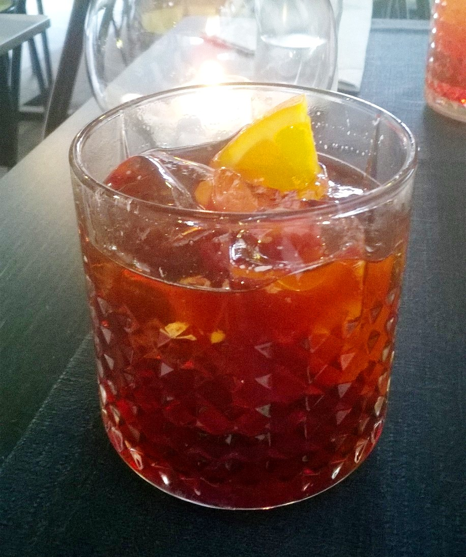My first Negroni of the night and the best! Finished with a subtle float of ginger beer, exquisite!