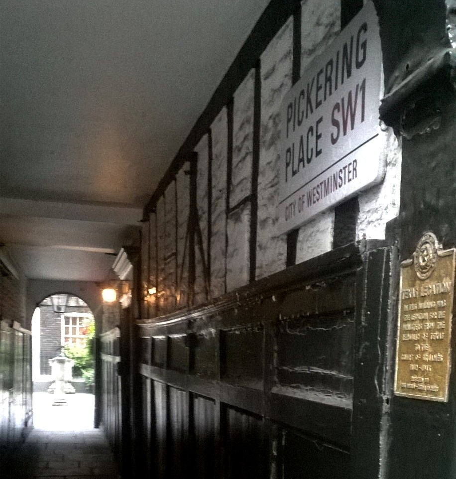 Alley to Pickering Place. Texas Embassey plaque on the far right with the old Tudor tennis court wall of No.3 clearly visible.