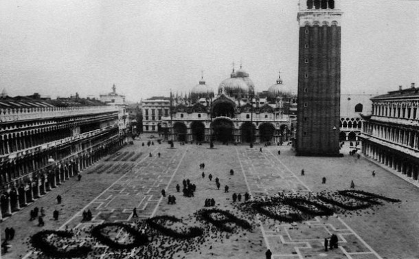 Coca-Cola logo written in pigeons, San Marco Square, Venice, Italy.