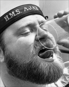 Sailor aboard the HMS Axia drinking a final tot on Black tot Day.